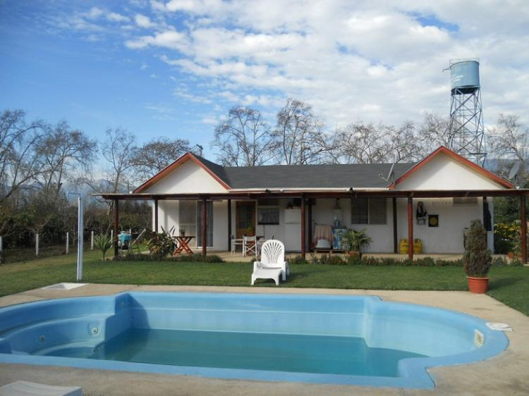 parcela de mtrs con casa muy acondicionada piscina